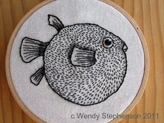 cool puffer fish. Embroidery and colored pencil.