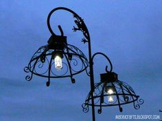 Dollar Store outside hanging lamps -- shepherd's hook, wire hanging plant baskets, solar lights