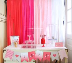 Cheap & easy backdrop. Could also use plastic tablecloths in varying shades of pink to white