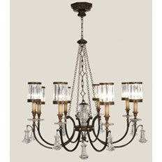 """""""This gorgeous chandelier has crytal sparkle, but aged metal and candles make it fit with the rustic room."""""""