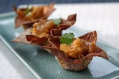 Curried coconut mango chicken in wonton cups