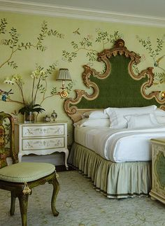 Pretty green bedroom with hand painted chinoiserie walls. Fab furniture.