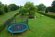 Grand Trampoline octogonal de jardin WAOUUH ! - France Trampoline