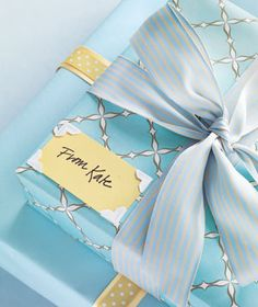 Photo corners as gift tag securers.