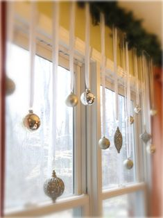 Hang ornaments from the windows, great idea! Do this this year...