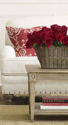 White sofa with red and white ikat throw pillow