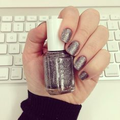 """We call this the """"TV static mani."""" Our Juliette is wearing @Essie Martin in Ignite the Night."""