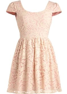Primrose Lace Dress: Features a chic round neckline with an alluring crossed V-back design, retro cap sleeves, soft lace shell layered over a pink cotton liner, and a ravishing gathered lace skirt to finish.