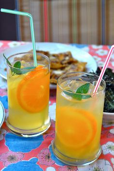 Pineapple Sangria ...  1 bottle of white wine  1 medium orange sliced into wedges  1 lemon sliced into wedges  2 cans of crushed or sliced pineapple  1/4 cup of sugar    Chill this in the fridge til it's nice and cold and then add right before serving:    4 cups of ginger ale  3 shots of coconut rum