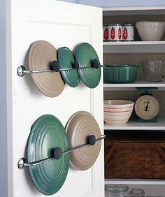 lid organization with towel racks on the back of the cupboard!