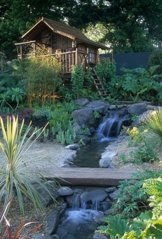 My Shloer garden designed for the 2001 Chelsea Flower Show with tree house in the background. Photography by Jerry Harpur www.judithsharpegardens.co.uk
