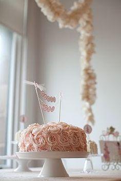 love the ruffle garland and rosette cake - Baby girl shower cake?