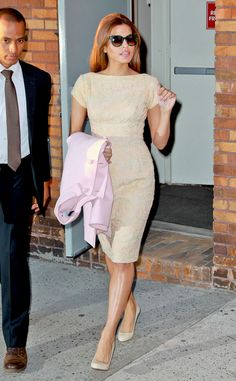 Eva Mendes pairs her classy knee-length frock with matching heels.