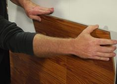 Flooring on a Wall  works well with laminate remnants from your retailer's clearance section