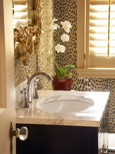 Afrocentric Style - Follow Me on Pinterest, Suzi M, Interior Decorator Mpls, MN leopard wallpaper in a bathroom