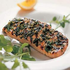 Grilled Herb Salmon - Finely chopped herbs create a flavorful crust on this grilled salmon, which is low in both calories and sodium.