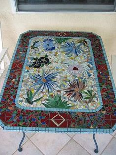 Red,white and blue flowered mosiac table
