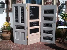 Rustic doors hinged together. Painted with chalkboard paint