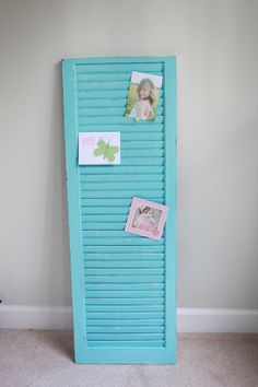 Painted shutter....pretty way to display photos.