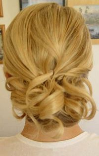 low messy bun cute with a curled bang  **We could do this for prom with your short hair, but add a braid or something**