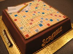 Scrabble Cake - Cake for my awesome mom! HUGE thank you to Kello here on CC who provided soooo much help and inspiration!  Cake is German chocolate, filled w/ chocolate mousse, covered in dark chocolate ganache and fondant.  Score sheet, letters and letter trays are fondant/gumpaste mix. Edible image over board & score sheet. Scrabble words on front are fondant/gumpaste with gold luster dust.