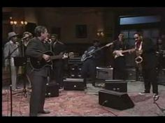 Leonard Cohen w/ Sonny Rollins (!) - Who By Fire -  Leonard Cohen performs his classic song with a mind-blowing assist from saxophone giant Sonny Rollins. from the short-lived US TV show Sunday Night, 1989