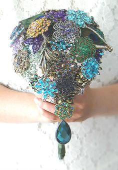 Cascading Peacock Brooch Bouquet with real peacock feathers by Silver Stems