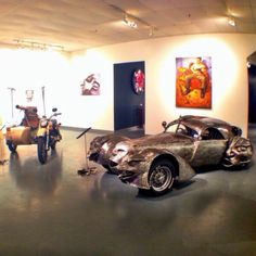 """The museum, also known as the """"Garage Mahal"""" features art cars.  They are factory made vehicles that are transformed into very imaginative personal statements or expressions. Don't be surprised to find a giant metal rooster art car travelling around Discovery Green."""