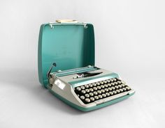 Smith Corona!  typewriter with a carbon ribbon.  Mom had one. If you needed to change a paragraph in your paper you had to start over.