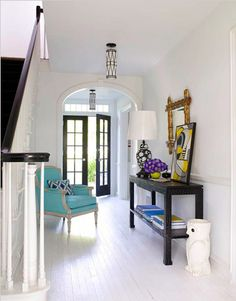 foyer idea...love the turquoise chair