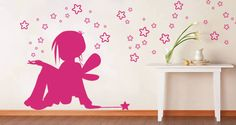 A graceful design of a little fairy with a magic wand and stars is featured on this premium wall decal. There are 24 different colors to choose from and 4 sizes. Starts at $48.