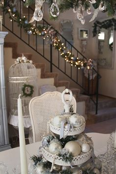 love the small wreath on the birdcage