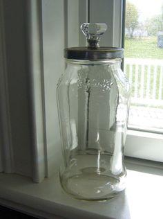 decorative jar made from a spaghetti sauce jar  simply add knob!