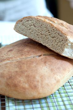 Whole Wheat Sourdough Bread.  This is a wonderful tutorial with recipes.  In order to make a great sourdough bread you need a started.  There is a recipe for a starter here.  Some starters are 100's of years old!!  Try this.  Your family will thank you.
