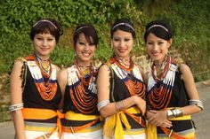 Chakhesang girls wearing tiza tida. Tiza is the carnelian beads which makes up the central part of a Tida, a necklace worn by the women of most Naga tribes. It is a broad, heavy, delicate and beautiful jewelry made up of carnelians, agate, ivory, glass beads etc, laced together in specific patterns. Traditionally, a Tiza is a girl's prized possession. On attaining puberty, it is gifted to the daughters by their mothers. The number of strands and quality of the Tiza denotes wealth and status.