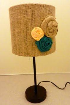Mod podge burlap onto lamp shade- secure tops/bottoms with glue gun. Hot glue flowers- ta da!