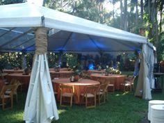 Tented outdoor wedding reception at Sunken Gardens in St Petersburg, Florida.