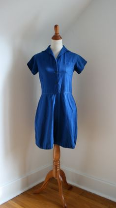 """1940s Blue Gym Bloomers Romper - one-piece """"Man o' War"""" label garment is an example of the standard issue """"uniforms"""" girls wore for physical education class (called gym bloomers due to the sweet puffed elastic cuffed legs!). Made of broadcloth with shirt style collar; buttons down front to waist."""