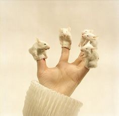 Nathalia Edenmont. porcelain finger puppets...not sure if this is sculpture or functional! :)