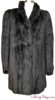 Black Mink Stroller Jacket #BM672; Excellent Condition; Misses 4 - 8. This is a gorgeous genuine dyed black mink fur stroller jacket. It has a Tibor Furs label and features a small shawl collar, elasticized sleeve ends and lightly padded shoulders. The lining is black with a beautiful geometric pattern woven in the fabric and there is an embroidered name monogram. This black mink stroller jacket is very versatile and may be dressed up or down. When you slip it on you will feel radiant!