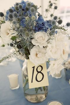white flowers, blue flowers, color, weddings, floral arrangements, mason jars, wedding centerpieces, table numbers, blues