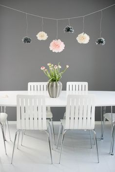 low hanging pom poms over kitchen/living room entry