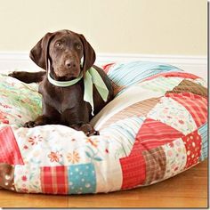 DIY Dog Bed- we love this patchwork quilt bed. It looks so comfy!