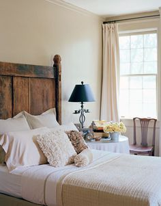 headboard: 18th century stall divider from a horse barn. YES.