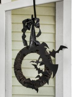 Flying Bat Wreath - Our 50 Favorite Halloween Decorating Ideas on HGTV