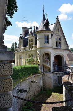 """Château Mouchy-le-Châtel, Conciergerie, Picardy, France. So... I love towers and spiraling staircases and """"older"""" feeling houses. You could definitely copy some parts of this for a real house!"""