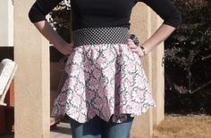 Reversible scalloped apron tutorial.  I made this a year ago and it turned out nicely.  It does use a lot of fabric to give the fullness.  The scallops are cute.