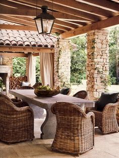 Love this stone table. I still remember whicker chairs from my childhood. #decor #design #home #outdoors