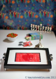 DIY Mike & Ike candy mosaic Chanukah tray. Use it for menorah lighting, to display your dreidel collection, or to serve candy at your Hanukkah party!