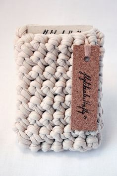"Crocheted cotton jersey iPhone sleeve by flylikeabutterfly via etsy.  ""The fabric used for this product are leftover, cotton jerseys, from the fashion industry."""